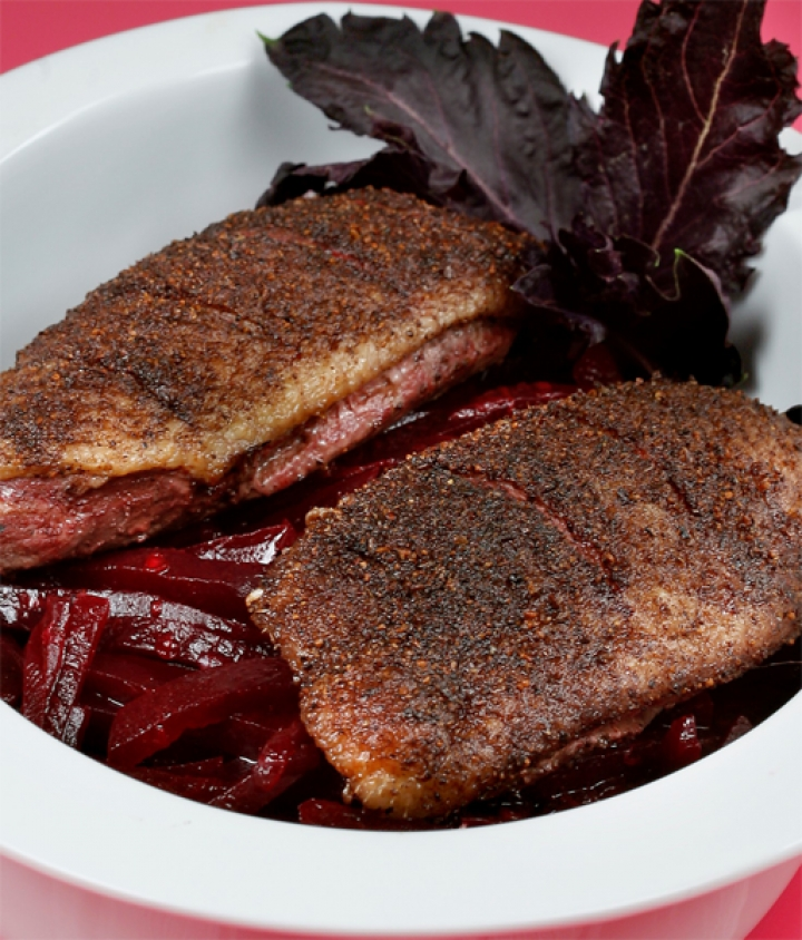 Five spiced duck breasts over curried beetroot